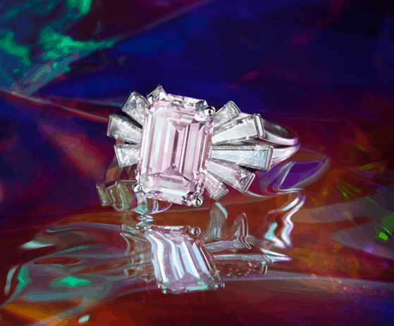 An Exceptional Fancy Pink Diamond and Diamond Ring