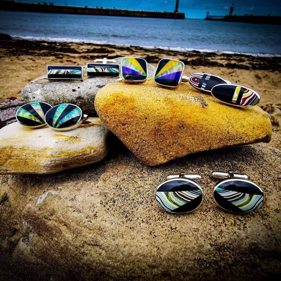 Whitby jet cufflinks featuring Fordite and synthetic opal