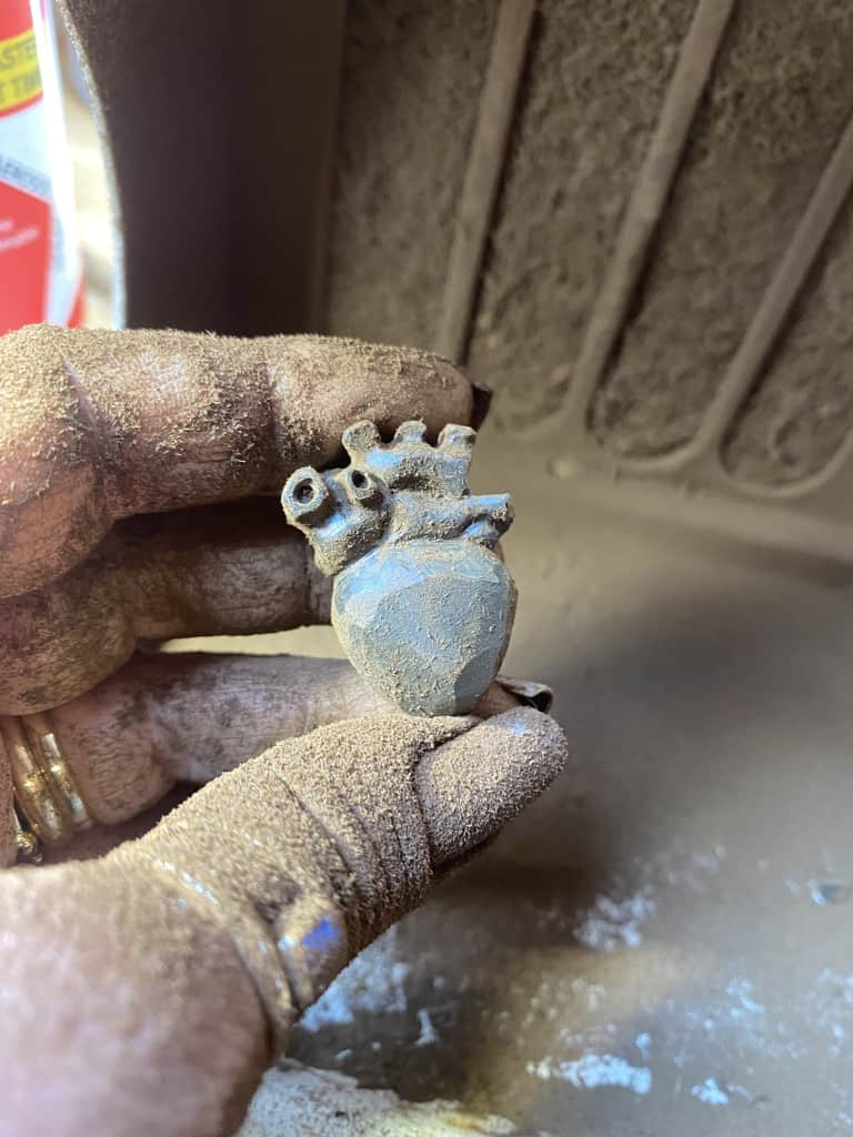 The carving of an anatomical heart in progress