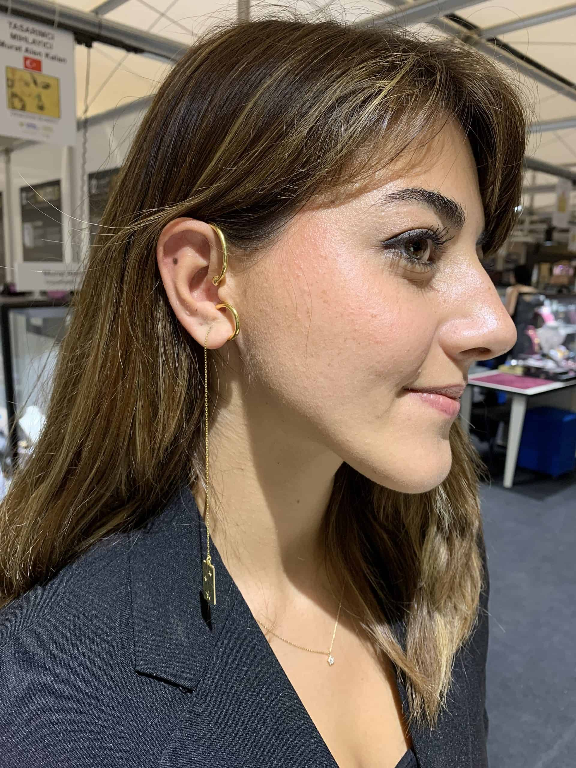 Asya Ozkan shows off her silver ear cuff at the Istanbul Jewelry Show